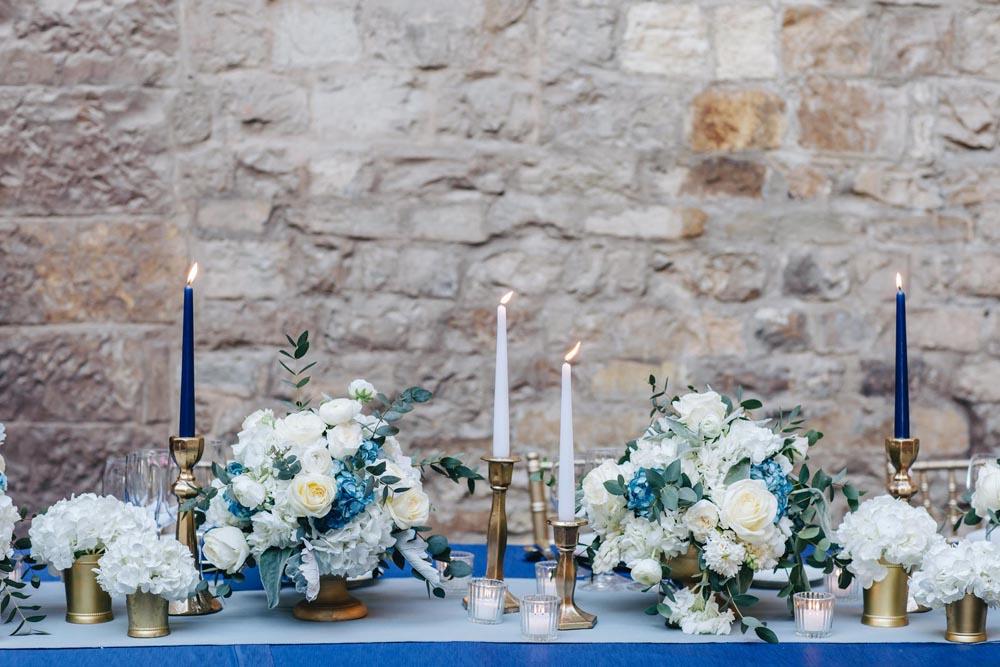 Blu setting white candle reception setting